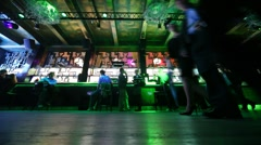 Front view from floor on some people sitting and relaxing at bar Stock Footage