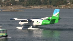 Float plane crossing water taxi in Victoria harbor, British Columbia, Canada Stock Footage