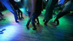 Legs of many dancing men and women in nightclub Stock Footage