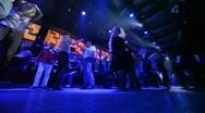 View from floor on dancing men and women in nightclub Stock Footage