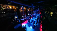 View from about on people dancing in nightclub with illumination Stock Footage