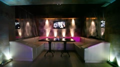 lounge zone in some nightclub with one table and leather sofa - stock footage