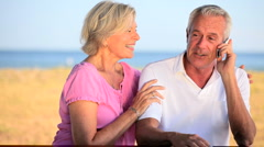 Affectionate Retired Couple Using Cell Phone - stock footage