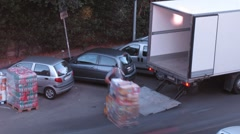 Some men load boxes on truck with pallet jack, Rome, Italy. Stock Footage
