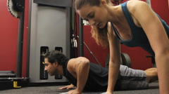Duo Pushups in Gym Stock Footage