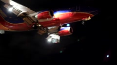 SOUTHWEST JET LANDS AT NIGH Stock Footage