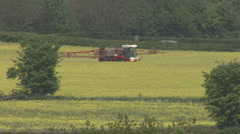 Crop sprayer in a field of Rapeseed disturbs a deer. Stock Footage