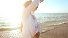 Romantic Seniors Dancing on the Beach Stock Footage
