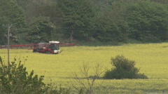 Crop sprayer in a field of Rapeseed. Stock Footage