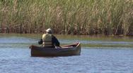 Man Fishing In Canoe Stock Footage