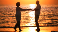 Romantic Sunset Beach Dancing Stock Footage