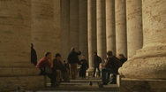 Nun walking through St Peters Columns Stock Footage
