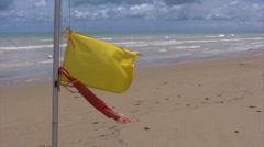 Yellow - Red flag on an italian beach Stock Footage