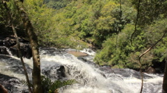 Water cascading down rocks viewed from above Stock Footage