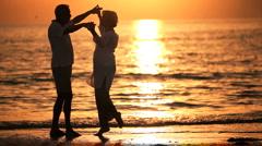 Romantic Sunset Beach Dancing Stock Footage