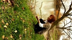 Woman picking flowers Stock Footage