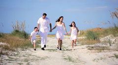 Family Running Fun on the Beach Stock Footage