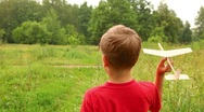 Boy is flying a toy aircraft Stock Footage