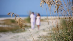 Attractive Couple Walking the Beach Stock Footage