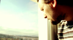 Sad man by the window - stock footage