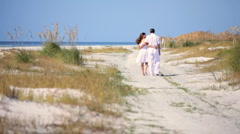 Contented Couple Walking the Beach Stock Footage