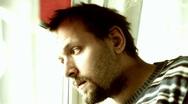 Sad man by the window Stock Footage
