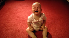 Baby crying on the floor - stock footage
