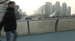 People walk on a bridge in Seoul Stock Footage