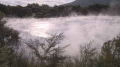 Steam on pond of hot geothermal water  Stock Footage