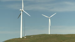 Huge wind turbines and service van shows scale Stock Footage