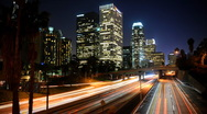 Stock Video Footage of Los Angeles Skyline, Highway Traffic, Aerial City Night LA Downtown, Time Lapse