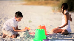 Young Children Playing in the Sand Stock Footage