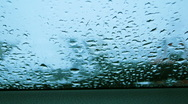 Stock Video Footage of Rain drops on a car window time lapse