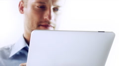 Concentrated man to check something. Stock Footage