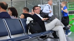 Man in airport with notebook Stock Footage
