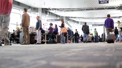 Timelapse of people walking carrying luggage in airport terminal Stock Footage