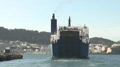 Vehicile ferry departs port Stock Footage