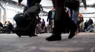 Stock Video Footage of Airport terminal with lots of people carrying luggage