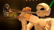 Stock Video Footage of Toyota Partner Robot Plays the Trumpet