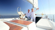Stock Video Footage of Successful Seniors Aboard their Yacht