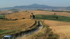Car travelling though farmland, Pienza, Tuscany, Italy - stock footage