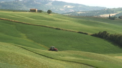 Tractor Cutting the Hay, Pienza, Tuscany Italy Stock Footage