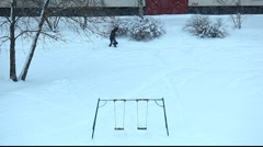 Snowy scene with swing. Anonymous and dog walking from left to right. Stock Footage