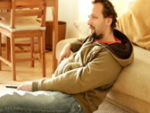 Man sitting on the floor and watching tv Stock Footage