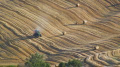 Farmer Harvesting the wheat crop, Pienza, Tuscany, Italy Stock Footage