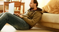 Man with laptop on the floor Stock Footage