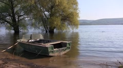 Aluminium motorboat  swaying on the spring river waves Stock Footage
