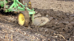 Tractor plowing a field Stock Footage