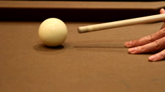 Aiming and shooting a white cue ball. - stock footage