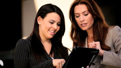 Businesswomen Using Wireless Tablet - stock footage